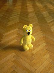 Der gelbe Bär auf dem Parkett