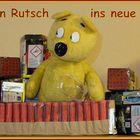 Der gelbe Bär wünscht einen guten Rutsch ins neue Jahr