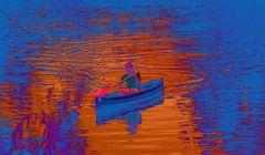 Der Paddler im blauen Wasser