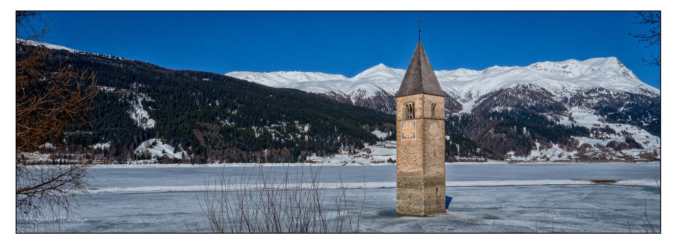 Der versunkene Turm im Reschensee, das Wahrzeichen des Vinschgau