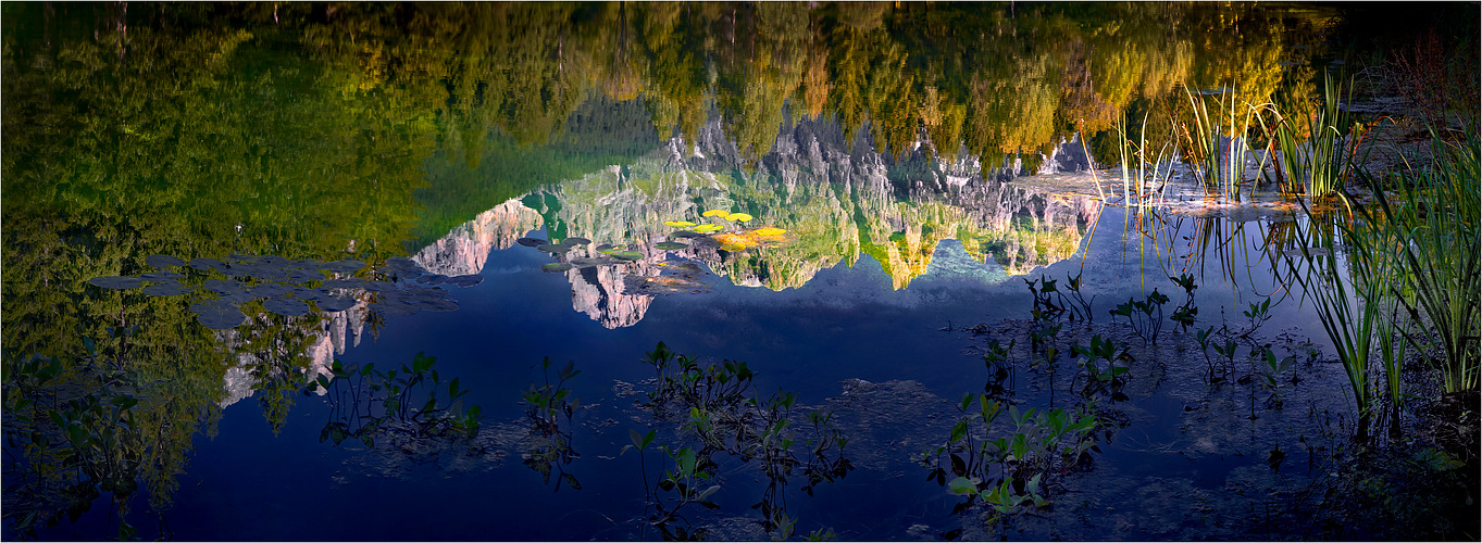 Die Berge der Pala-Dolomiten spiegeln sich im Lago Welsperg