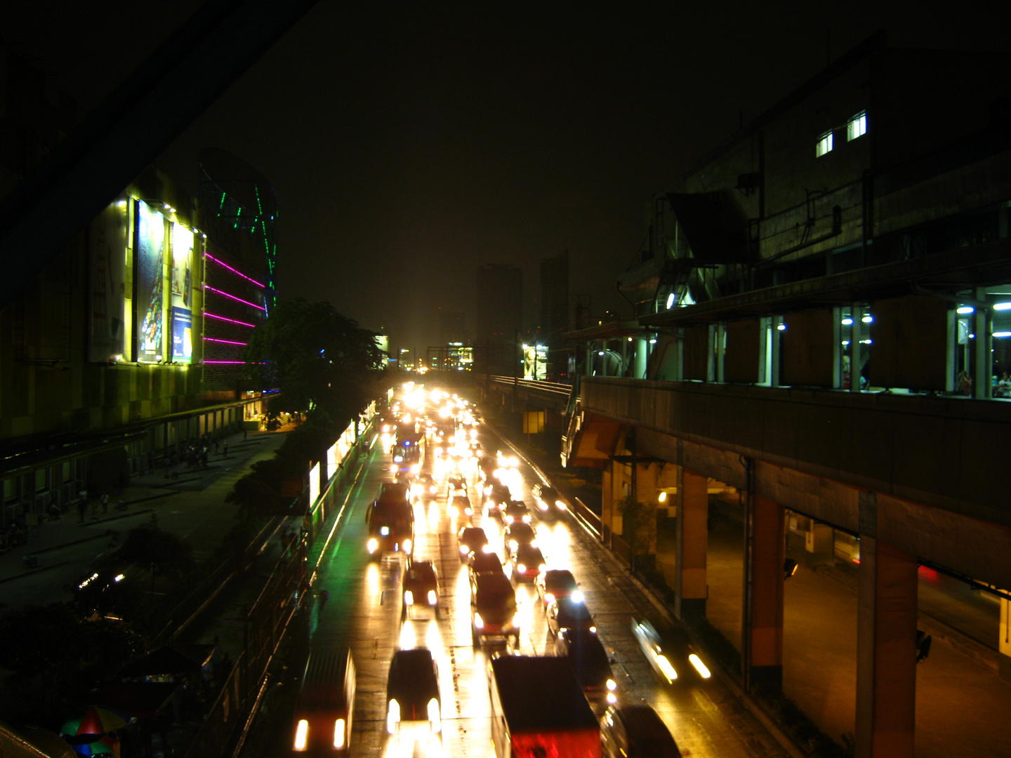 EDSA at Night - A View from a Window at a Railway Station