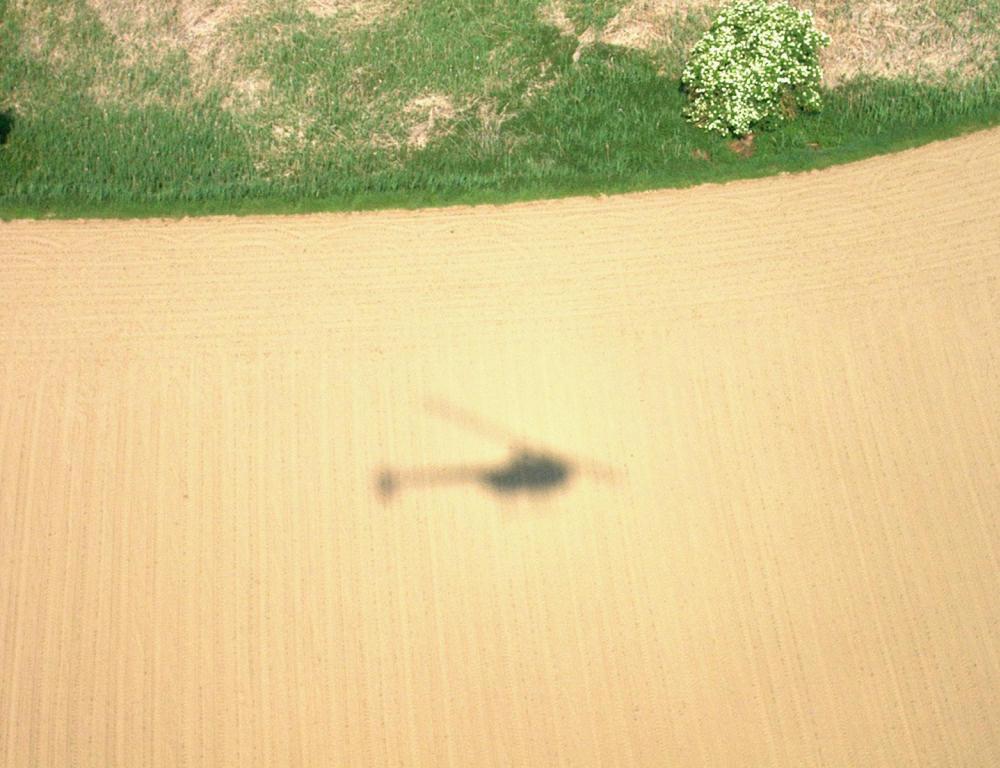 Ein Schatten im Muster der Landschaft
