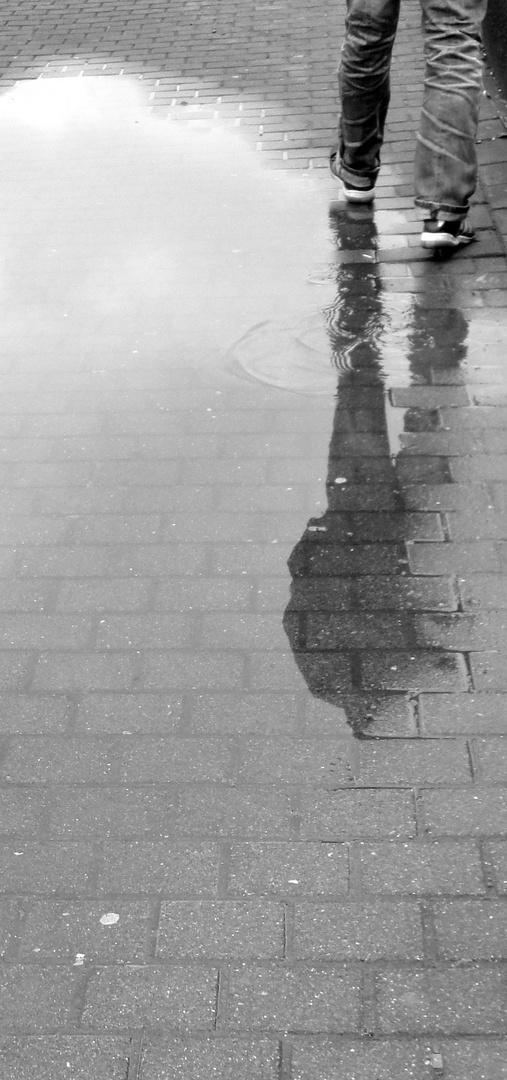 Ein Schritt im Regen
