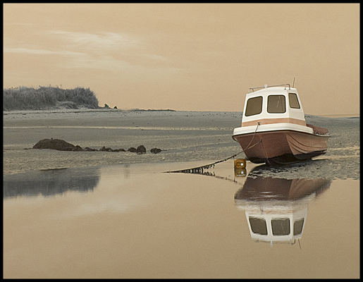 estuary boat reflection