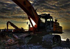 excavator in the evening sun