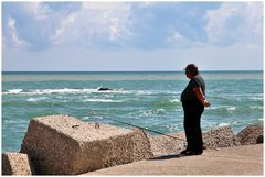 Fat fisherman waits