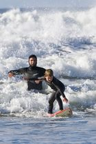 Father and son surf lesson in Morro Bay, CA.