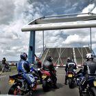 ... fellow motorcyclists waits for a bridge