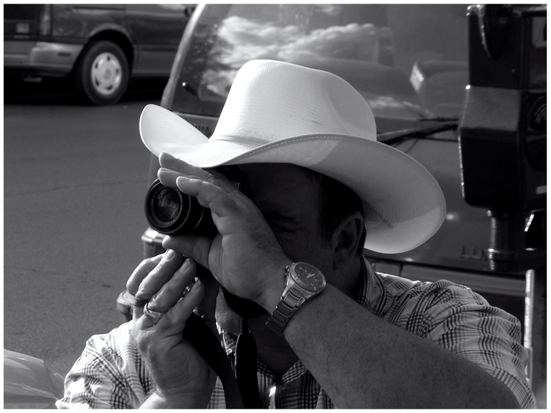 fellow picture-taking cowboy