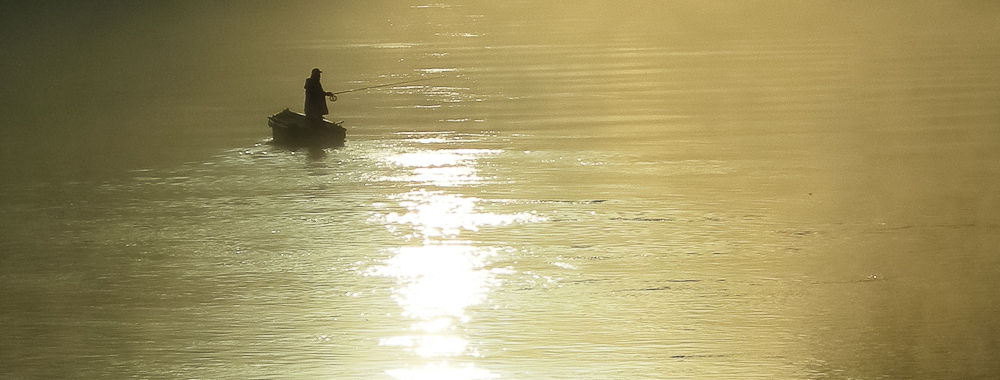 Fisherman and Fog in the morning sun