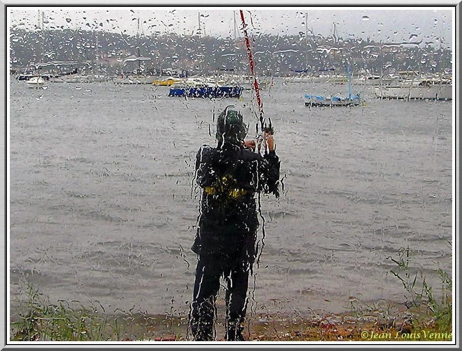 Fisherman under the rain.