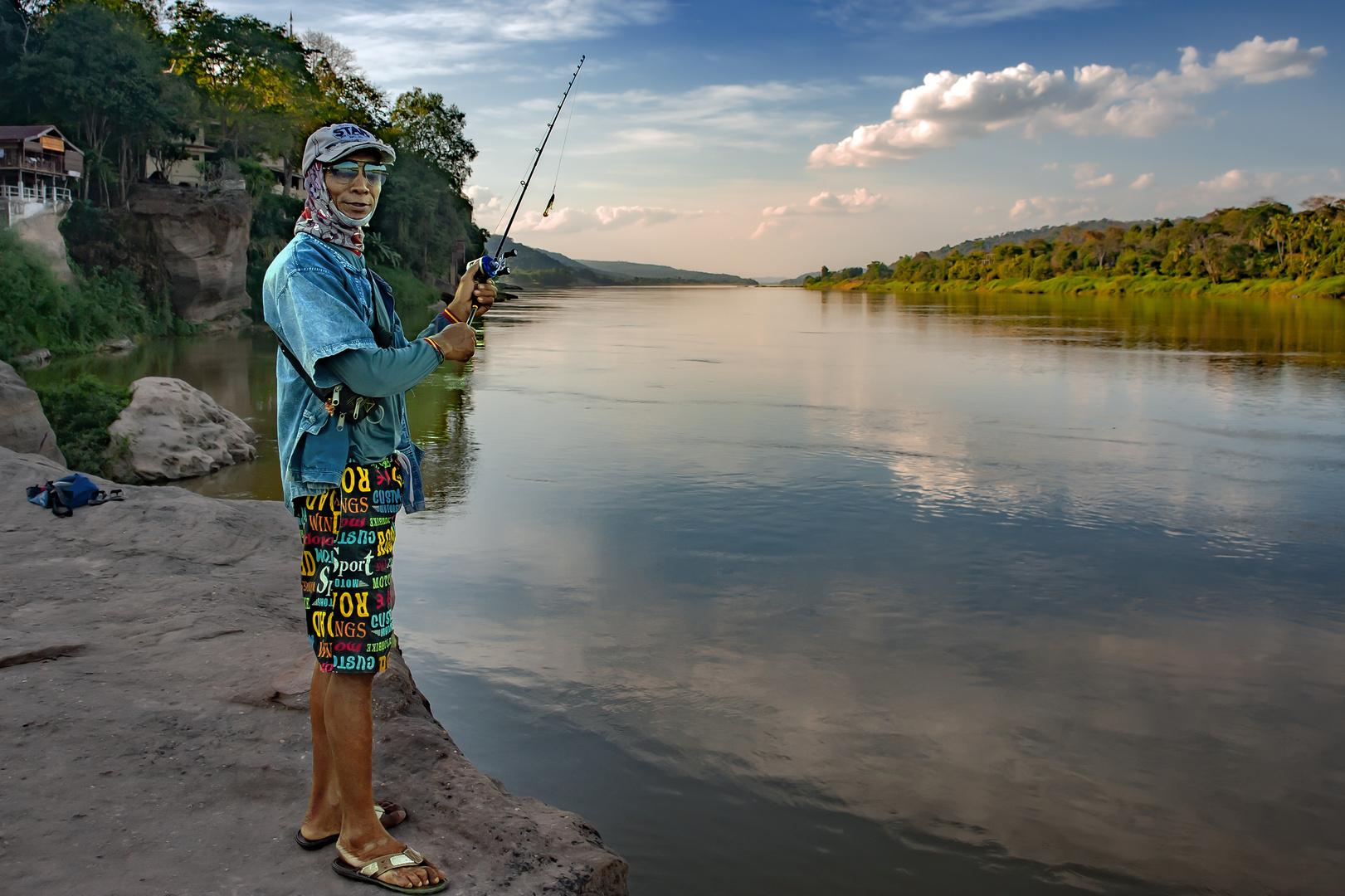 Fishing at the Mekong riverbank