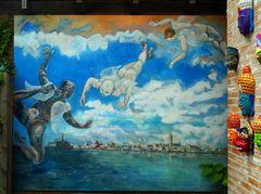 """ Fliegende Engel über der Stadt am Meer """