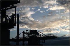 Fotografensilhuette vor Wolken