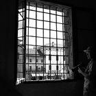 fotografo alla finestra