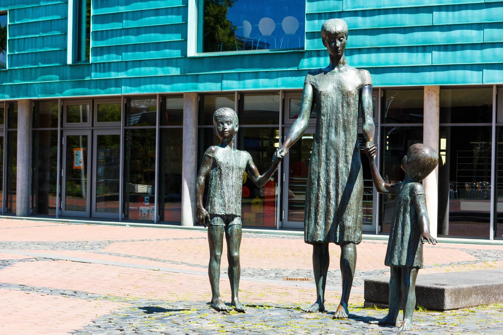 Frau mit Kindern