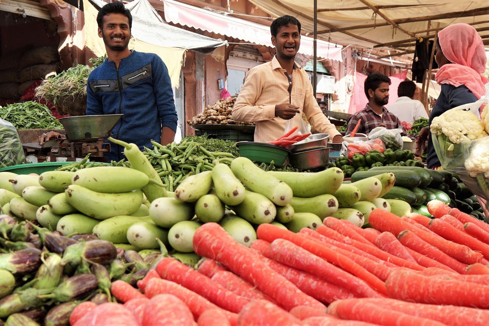 Fröhliche Gemüsehändler