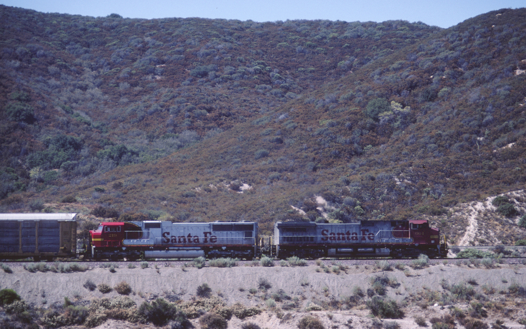 From the old Route 66 View on a passing Enclosed Carrier Cars Train on its way to Cajon Pass, CA