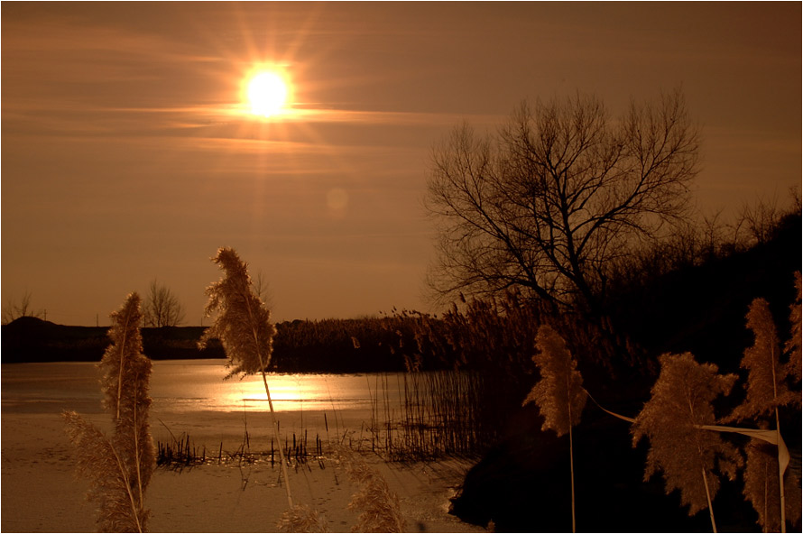 Frozen Lake in Winter Sunset