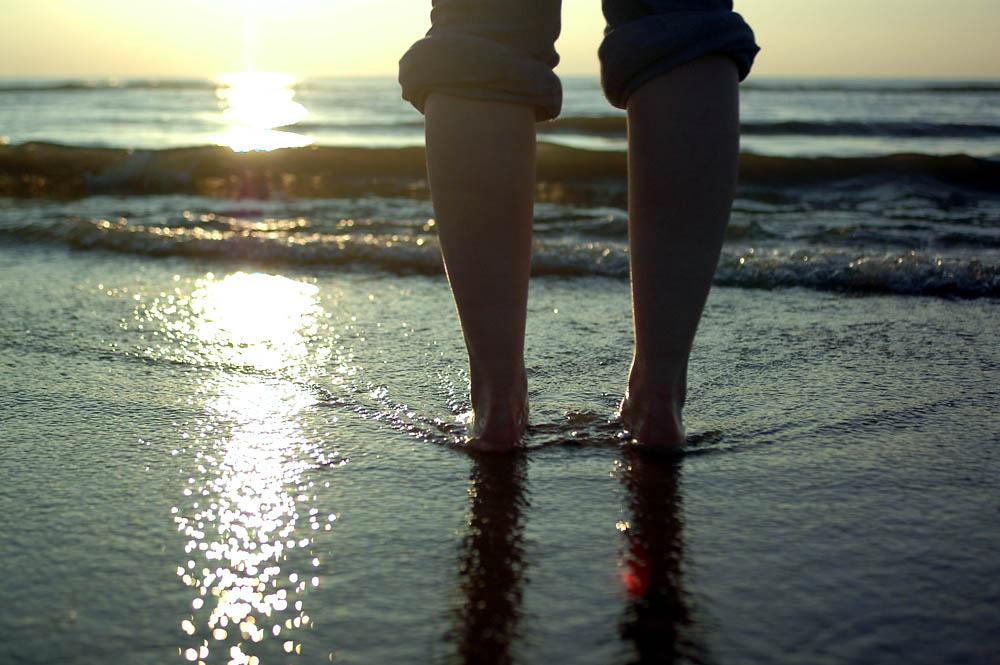 Füße im Meer Foto