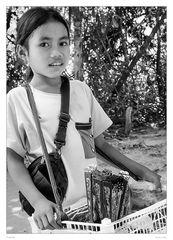 Girl selling souveniers