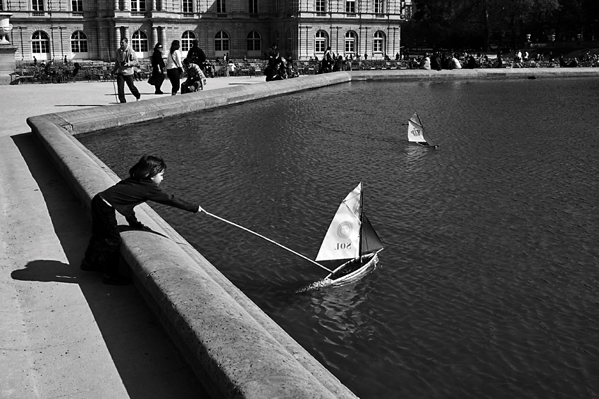 Girl with model boat in Jardin Luxembourg