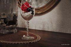Glasdeko mit Rose