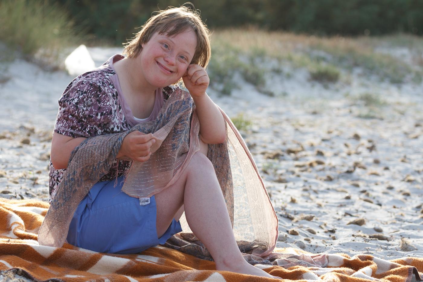 Glückliches Kind mit Down Syndrom