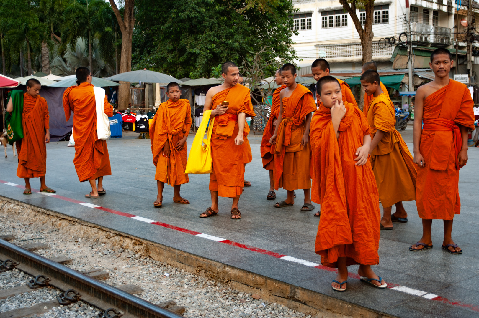 Group of monks having excursion