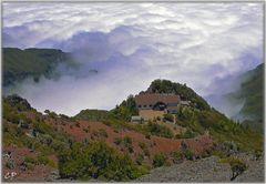 Haus in den Wolken