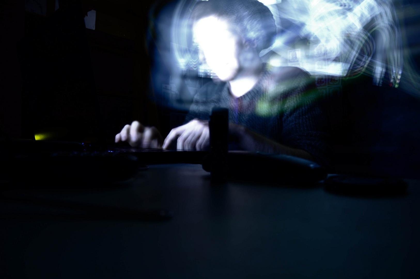 Hidden behind the screen, is a slender teen.