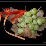 Hoja con uvas.