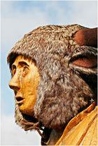 Holzkopf mit Mütze