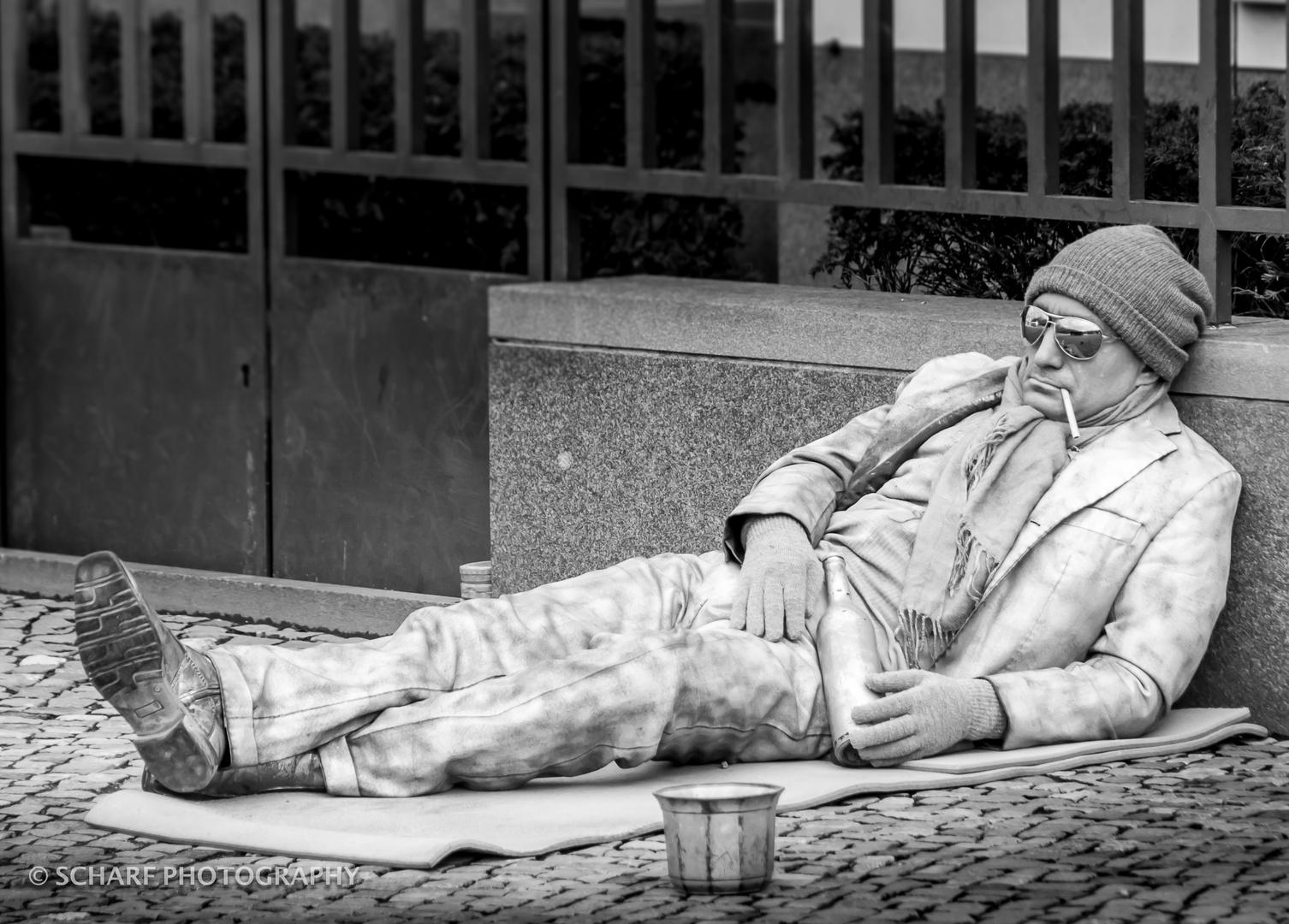 homeless silver guy