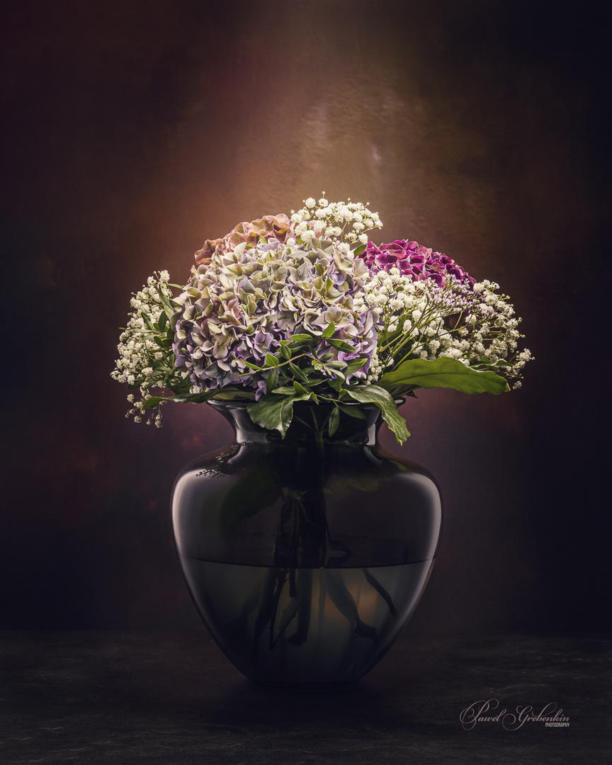 Hydrangea flower bouquet in glass vase