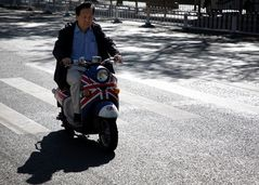 I ride a GS scooter with my hair cut neat Wear my wartime coat in the wind and sleet