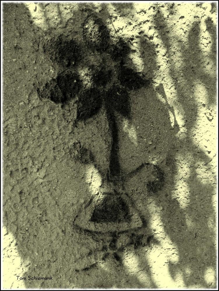 In den Sand gezeichnet