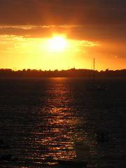 In Devin (Stralsund) geht die Sonne unter