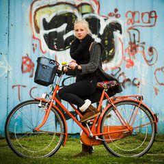 J. and her orange bike
