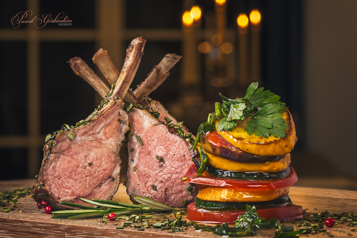 Juicy tender lamb chops sous-vide from grill with roasted vegetables