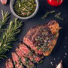 Juicy tender sous-vide grilled irish beef rump steak with fresh herbs