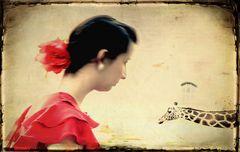 Junge Frau mit Giraffe