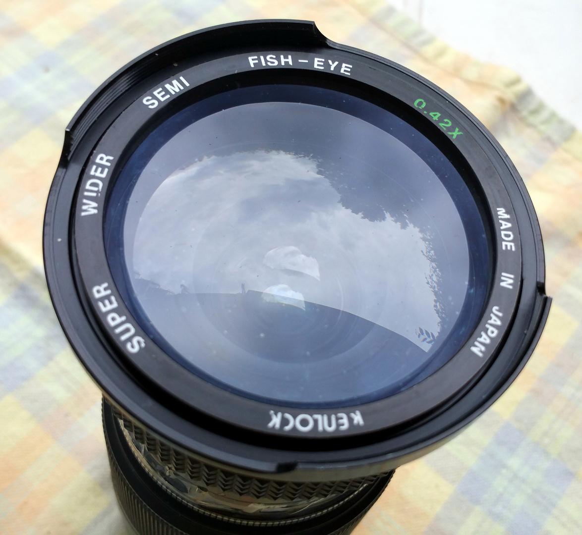 Kenlock Super Wider Semi Fish-eye 1991 + Sony DT 3.5-5.6/18–70 mm 2008