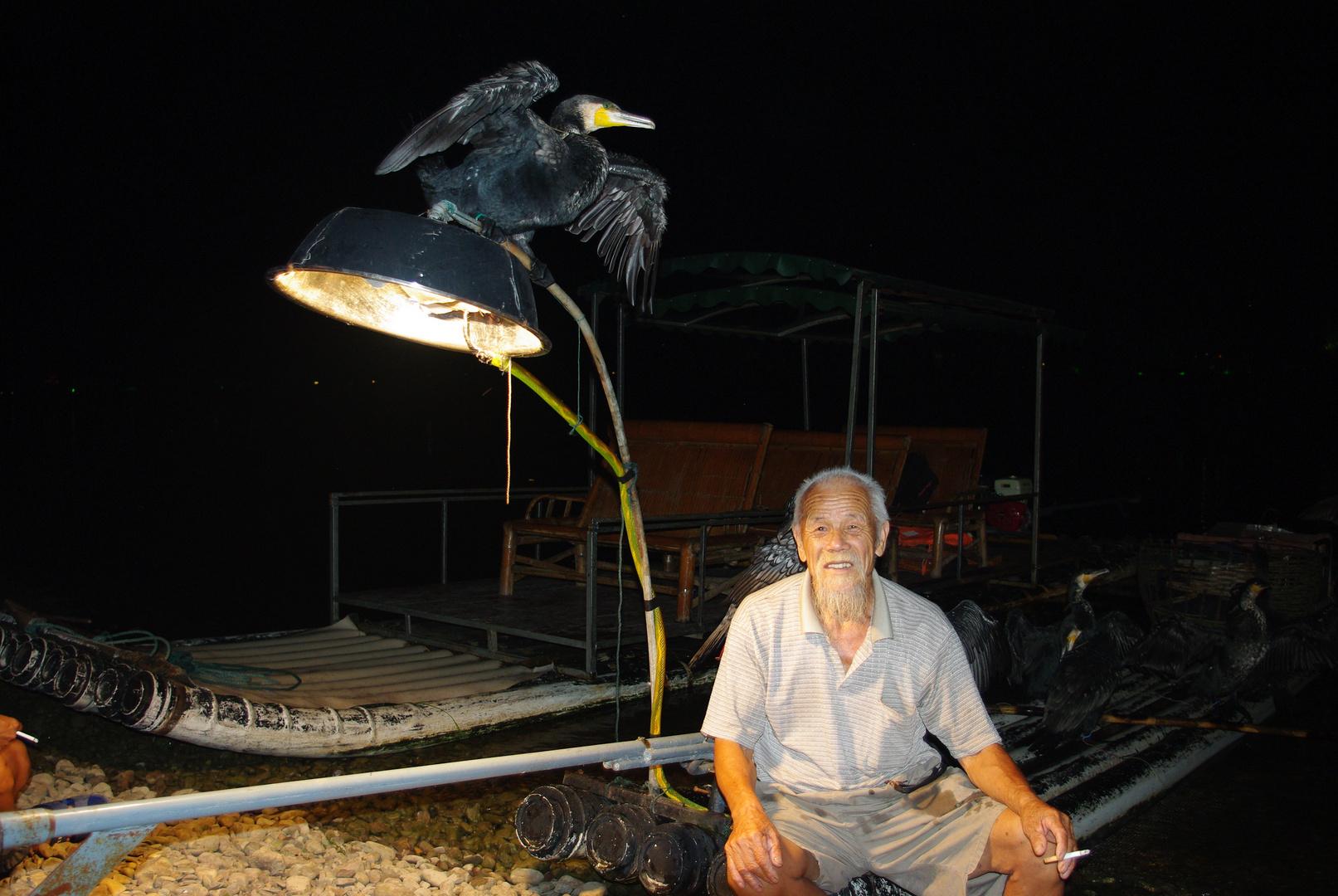 Kormoran-Fischer am Li-Fluss