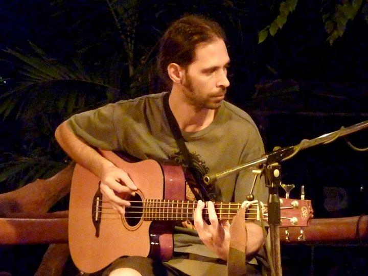Kosma Solarius on bass guitar