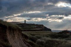 Küstenlandschaft mit Leuchtturm