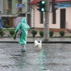 lady in green with white dog