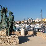 Lampedusa e la statua del pescatore