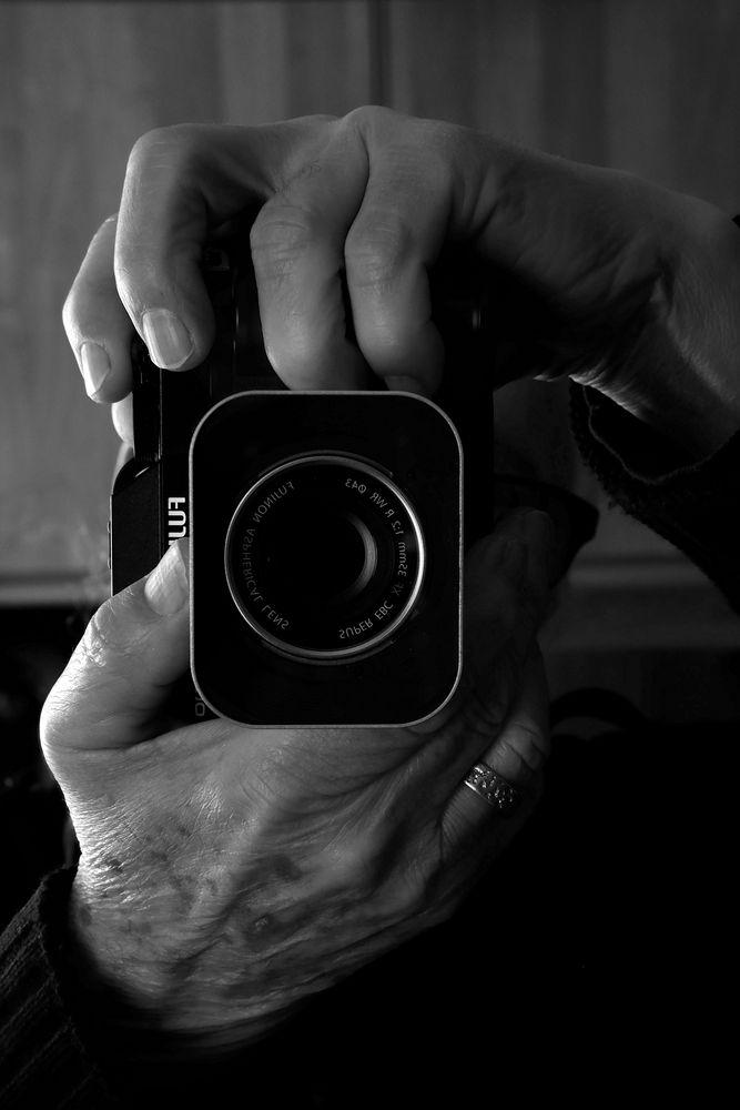 les mains du photographe